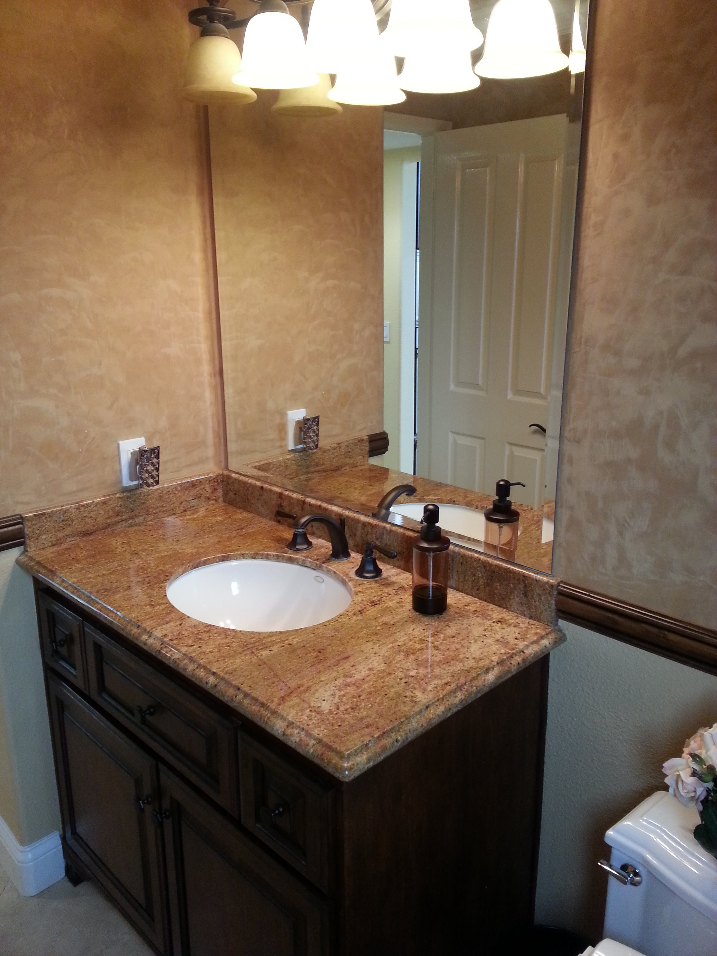 View of bathroom sink and mirror