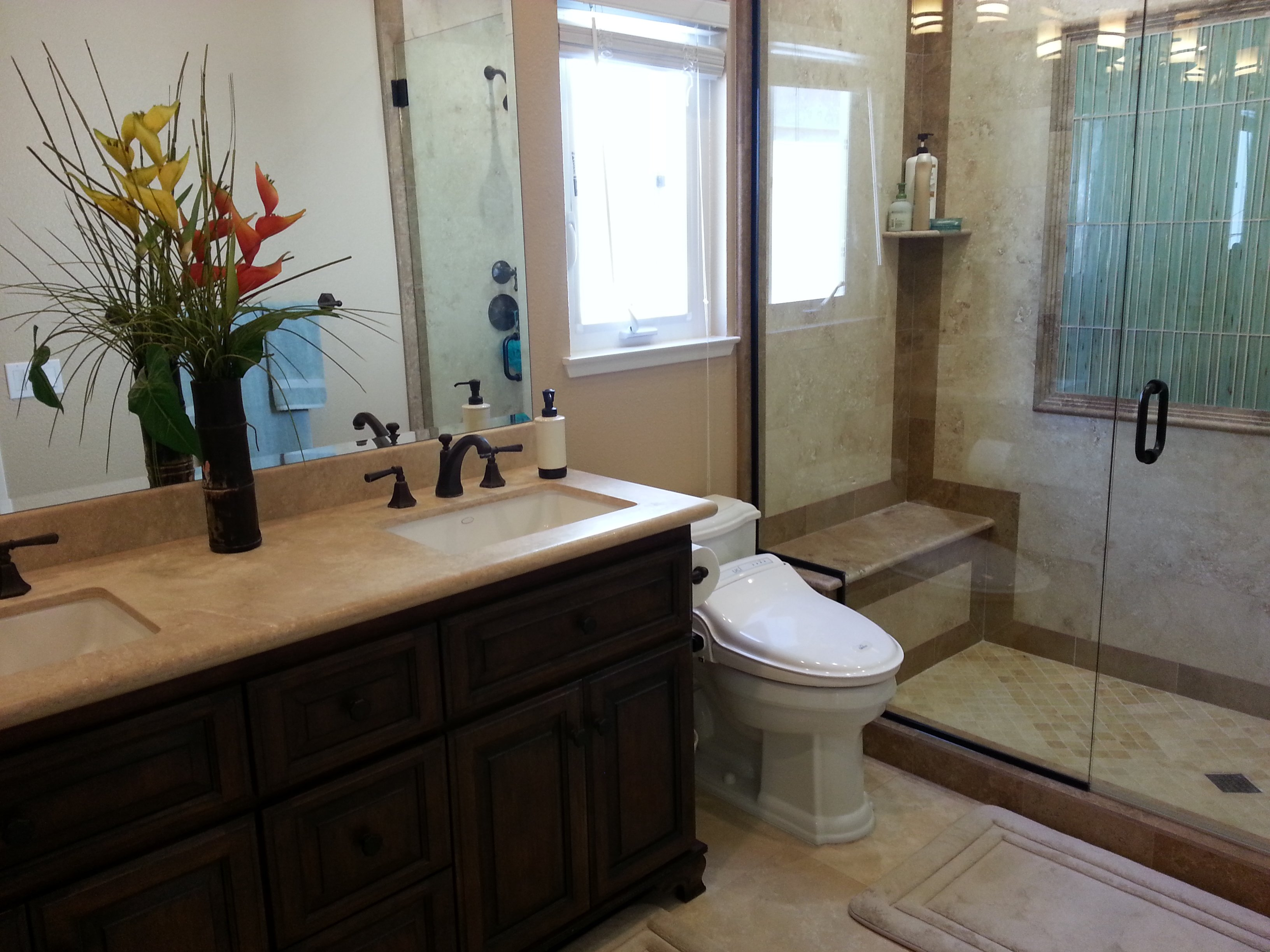 Bathroom with countertop and mirror