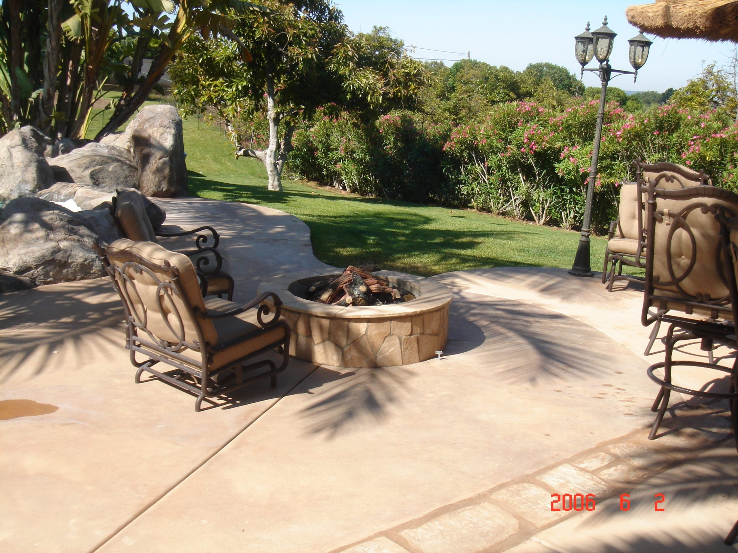 Chair around outdoor stone fireplace