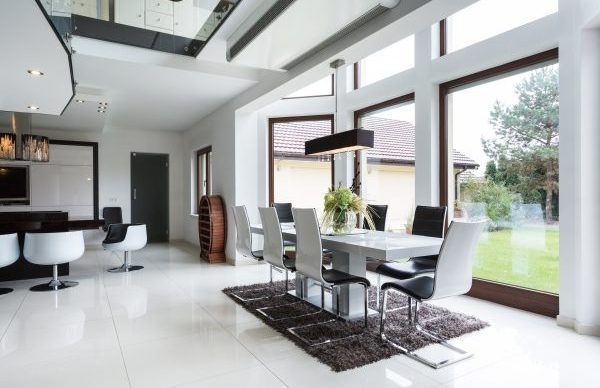 Airy dining area with white and black accents