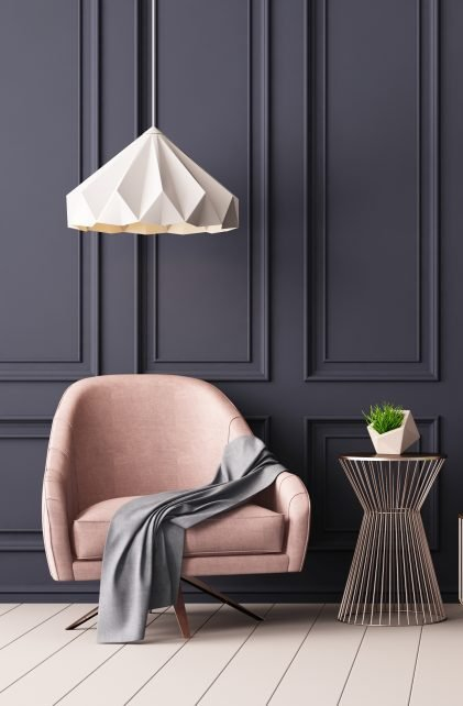Pastel interior in classic style with soft armchairs and lamps