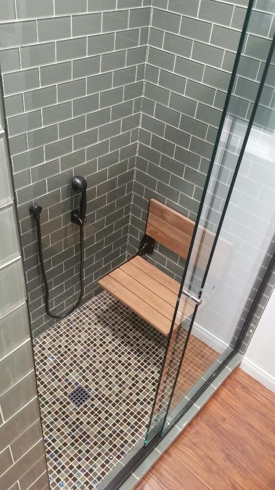 Shower stall with seating