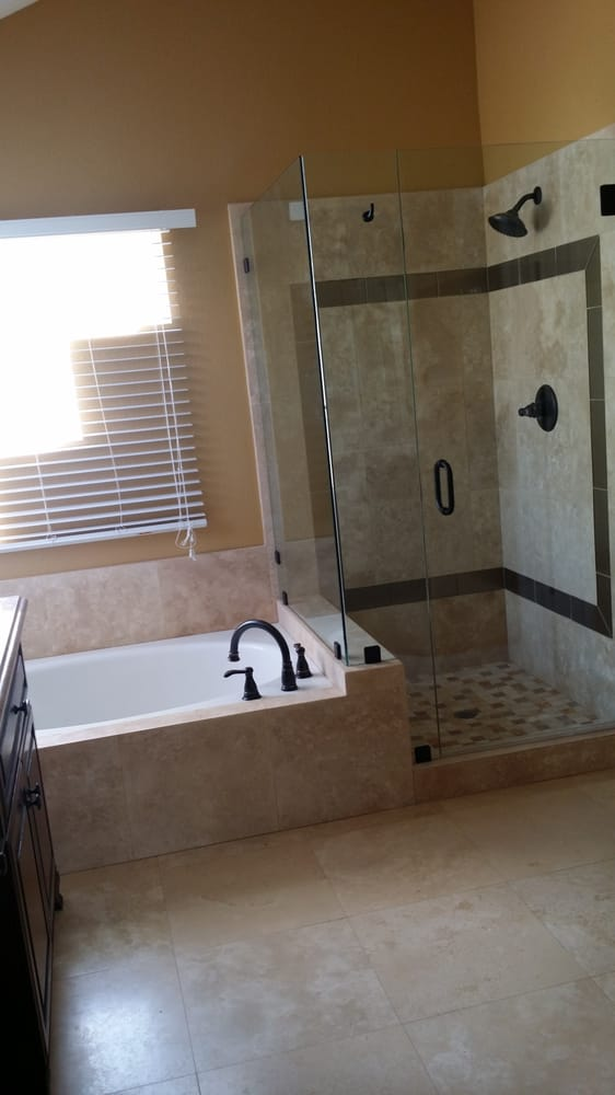 bathtub with attached shower
