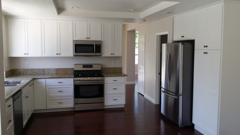 Stove with white cabinets