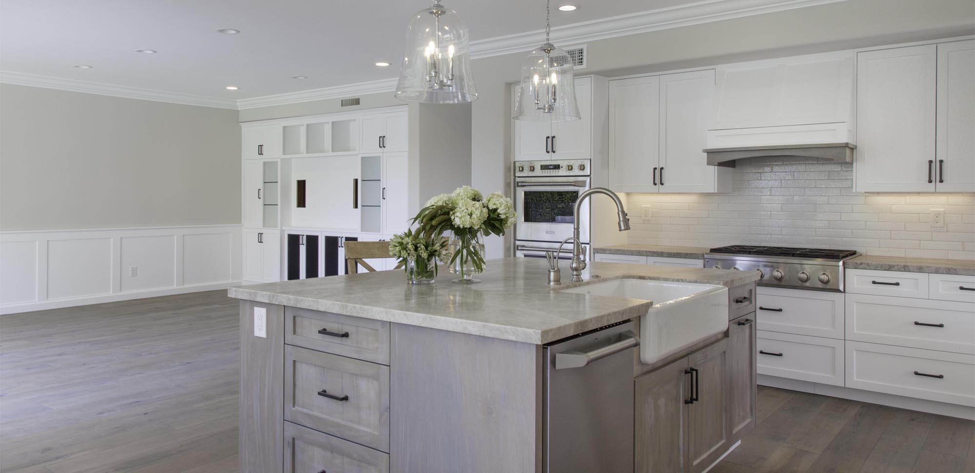 A newly finished kitchen with an attached dining area.